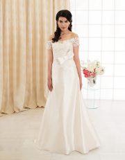 Langes Brautkleid ohne Träger aus Seide und Spitze mit großer Schleife vorne